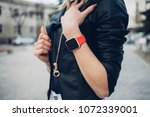 photo of female hands touching... | Shutterstock . vector #1072339001