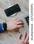 smartphone is charging by... | Shutterstock . vector #1072345091