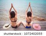 beautiful women doing yoga at... | Shutterstock . vector #1072402055