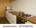 corner of the white kitchen.... | Shutterstock . vector #1072408781