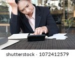 woman calculate domestic bills... | Shutterstock . vector #1072412579
