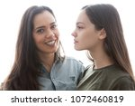 two sisters standing near each... | Shutterstock . vector #1072460819
