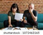 couple managing the debt | Shutterstock . vector #1072463165