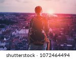 young tourist girl with... | Shutterstock . vector #1072464494