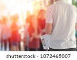 teacher with uniform students... | Shutterstock . vector #1072465007