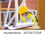 busy female architect working    Shutterstock . vector #1072471769
