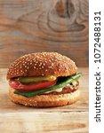 hamburger bun with sesame seeds ... | Shutterstock . vector #1072488131