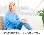 beautiful smiling woman sitting ... | Shutterstock . vector #1072507967