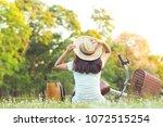 sitting woman near her bike in...   Shutterstock . vector #1072515254