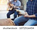 a man sing a song from hymn... | Shutterstock . vector #1072516454
