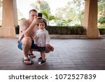 father and little boy on... | Shutterstock . vector #1072527839
