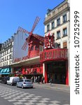 PARIS, FRANCE - MAY 19: The Moulin Rouge, on May 19, 2010 in Paris, France. Moulin Rouge is a famous cabaret built in 1889, located in the Paris red-light district of Pigalle. - stock photo