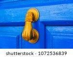 Door With Brass Knocker In The...