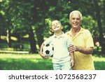 happy grandfather and child... | Shutterstock . vector #1072568237