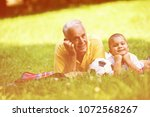 happy grandfather and child... | Shutterstock . vector #1072568267