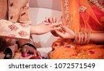 indian bride putting a wedding... | Shutterstock . vector #1072571549