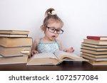beautiful little girl is... | Shutterstock . vector #1072577084