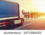 truck run fast on the highway... | Shutterstock . vector #1072586435