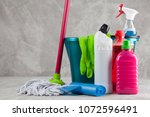 cleaning supplies on grey... | Shutterstock . vector #1072596491