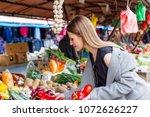 young long hair girl buying... | Shutterstock . vector #1072626227