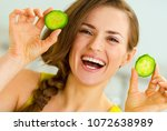 smiling young woman showing... | Shutterstock . vector #1072638989