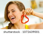 happy young woman using slice... | Shutterstock . vector #1072639001