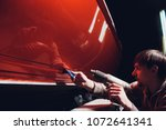 car wrapping specialist putting ... | Shutterstock . vector #1072641341