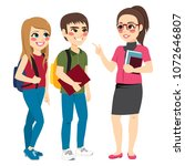 teacher talking with young... | Shutterstock .eps vector #1072646807