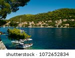 wooden boats anchored in a... | Shutterstock . vector #1072652834