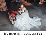 a beautiful bride is sitting in ... | Shutterstock . vector #1072666511
