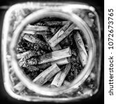 Small photo of Ashtray with cigarette butts. Harm from smoking.