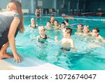female instructor teaches... | Shutterstock . vector #1072674047