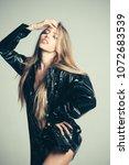 girl with long hair wears black ... | Shutterstock . vector #1072683539