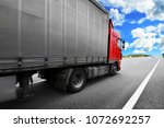 red truck with the grey trailer ... | Shutterstock . vector #1072692257