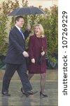 Small photo of VP Al Gore and Tipper Gore walk along stage during the official opening ceremony of the Clinton Presidential Library November 18, 2004 in Little Rock, AK