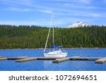 Small photo of North America, United States, Oregon, Eastern Oregon, Cascade Lakes Highway, Cascade Mountains, Deschutes National Forest, Mt Bachelor, Bachelor Butte, Elk Lake. Sailboat.