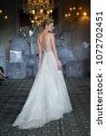 Small photo of NEW YORK, NY - APRIL 12: A model walks the runway during the Mira Zwillinger Spring 2019 Bridal fashion show on April 12, 2018 in New York City.