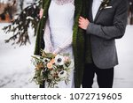 the bridegroom embraces the... | Shutterstock . vector #1072719605