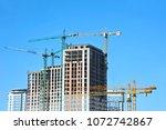 crane and building under... | Shutterstock . vector #1072742867