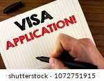 Small photo of Conceptual hand writing showing Visa Application Motivational Call. Business photo showcasing sheet to provide your basic information written by Man Notebook Book Wooden background Marker.