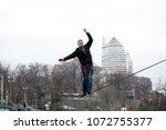 man balancing on slackline | Shutterstock . vector #1072755377