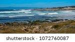 Waves Break Along The Rocky...