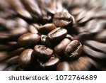 coffee beans with zoom burst... | Shutterstock . vector #1072764689