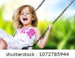 little child blond girl having... | Shutterstock . vector #1072785944