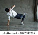 teenage boy in white sweater... | Shutterstock . vector #1072803905