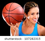 Female basketball player - isolated over a black background - stock photo