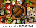 hot pot with double flavour... | Shutterstock . vector #1072829144