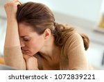 stressed young housewife in... | Shutterstock . vector #1072839221