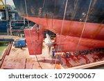 a cargo ship in dry dock | Shutterstock . vector #1072900067