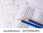 pencil on answer sheets or... | Shutterstock . vector #1072906391